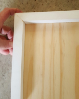 Shelf within frame